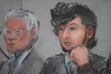 Accused Boston Marathon bomber Dzhokhar Tsarnaev (R) is shown in a courtroom sketch on the first day of jury selection at the federal courthouse in Boston, Massachusetts January 5, 2015. A U.S. judge on Monday began the process of selecting the jury that will hear the trial of Tsarnaev, telling the first of some 1,200 prospects to read no more news accounts about the deadly blasts.Tsarnaev, a 21-year-old ethnic Chechen who is a naturalized U.S. citizen, could get the death penalty if convicted of killing three people and injuring more than 260 others by detonating a pair of homemade bombs placed amid a crowd of thousands of spectators at the race's finish line on April 15, 2013.    REUTERS/Jane Flavell Collins    (UNITED STATES - Tags: CRIME LAW) - RTR4K4UY